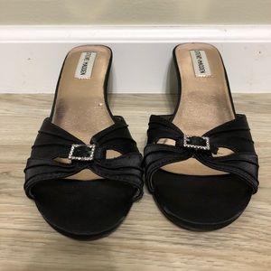Black satin kitten heels with rhinestone buckle.